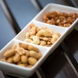 еда обрамляет смешанную nuts серию Стоковое Изображение