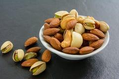 еда обрамляет смешанную nuts серию стоковые изображения rf