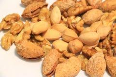 еда обрамляет смешанную nuts серию стоковые фото