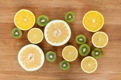 Еда цитруса плодоовощ на деревянной предпосылке Стоковое Изображение