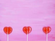 3 леденца на палочке на розовой предпосылке Стоковые Фотографии RF