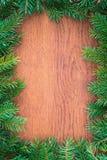 Ель рождества на деревянной доске. Предпосылки Стоковая Фотография RF