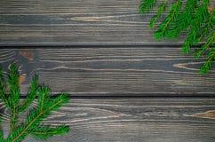 Ель рождества на деревянной предпосылке Стоковые Изображения RF