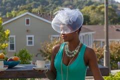 Жаждающ Lola, шляпами и чаем верхнего сегмента Стоковая Фотография RF