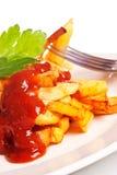 жарит картошку ketchup стоковая фотография