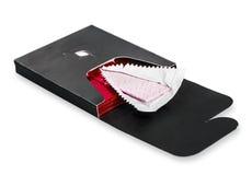 Жевательная резинка раскрытая в стандартной красной изолированной упаковке Стоковая Фотография RF