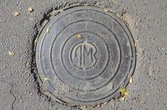 Железный люк с lm стоковое изображение rf