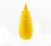 Желтая бутылка мустарда Стоковое Фото