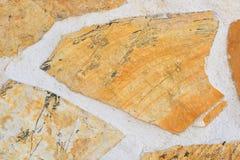 Желтая и белая каменная стена в стиле мозаики стена текстуры кирпича предпосылки старая Стоковые Фотографии RF