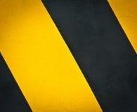 Желтая и черная маркировка дороги Стоковые Фотографии RF