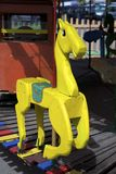 Желтая лошадь merry-go-round стоковое изображение rf