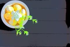 Желтые пасхальные яйца и белые цветки с темной деревянной предпосылкой бесплатная иллюстрация