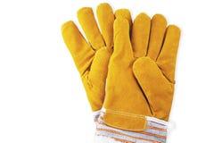 Желтые работая перчатки на белой предпосылке Стоковое Изображение