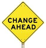 Желтый изолированный предупредительный знак - изменение вперед - Стоковые Изображения RF