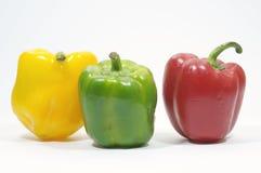 Желтый, красный и зеленый - сегодня мы варим 3 перца для colore Стоковая Фотография
