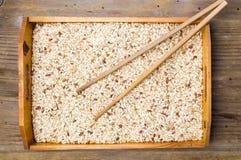 Желтый рис и деревянные палочки Стоковое Изображение