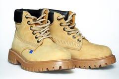 желтый цвет ботинок Стоковые Фото