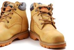 желтый цвет ботинок Стоковые Изображения