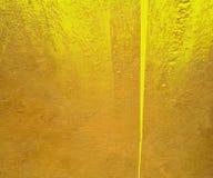 желтый цвет гипсолита глянцевой краски предпосылки Стоковые Изображения RF