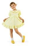 желтый цвет девушки платья счастливый Стоковые Изображения RF
