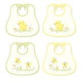 желтый цвет зеленого цвета bibs младенца Стоковые Изображения RF