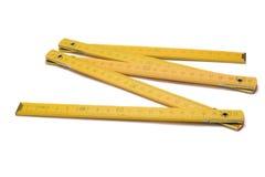 желтый цвет метра деревянный Стоковые Фото