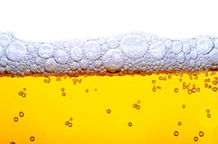 желтый цвет пены пива Стоковая Фотография