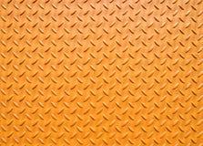 Желтый цвет покрасил промышленный стальной покрывать с текстурированной решеткой картиной настила стоковые фото