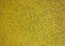 Желтый цвет предпосылки вплетенных потоков и краски Стоковое Изображение RF