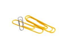 желтый цвет предпосылки изолированный зажимами бумажный белый Стоковое Изображение