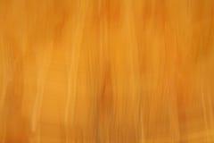 желтый цвет предпосылки коричневый померанцовый Стоковые Изображения