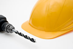 желтый цвет работников безопасности шлема сверла Стоковая Фотография