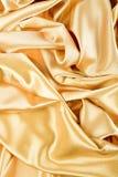 желтый цвет сатинировки предпосылки золотистый Стоковые Изображения