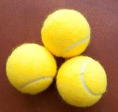 желтый цвет тенниса 3 шариков совместно Стоковые Изображения