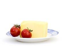 желтый цвет томата плиты сыра Стоковое Изображение