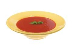 желтый цвет томата супа плиты Стоковые Изображения