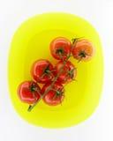 желтый цвет томатов плиты Стоковая Фотография RF