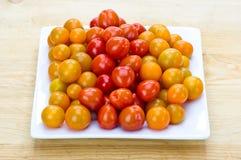 желтый цвет томатов померанцового красного цвета вишни Стоковые Изображения