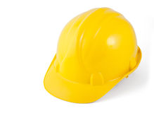 желтый цвет трудного шлема изолированный белый стоковые изображения