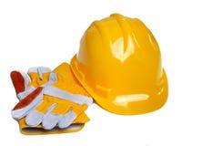 желтый цвет трудного шлема перчаток конструкции Стоковое фото RF
