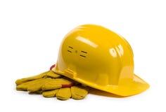 желтый цвет шлема перчаток Стоковые Фото