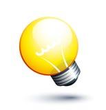желтый цвет lightbulb Стоковые Изображения