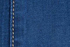 Желтый шов на джинсовой ткани стоковые фотографии rf