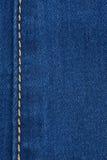 Желтый шов на джинсовой ткани стоковые изображения rf
