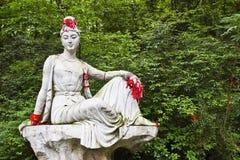 Женская буддийская статуя Стоковая Фотография