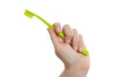женская зубная щетка удерживания руки Стоковые Фото