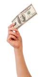 Женская рука 100 банкнот доллара изолированных на белизне Стоковые Фото