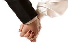 Женская рука в мужской руке Стоковое Изображение