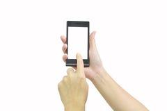 Женская рука держа современный умный телефон с белым экраном на whit Стоковая Фотография