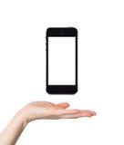 Женская рука держа умный телефон изолированный стоковая фотография rf